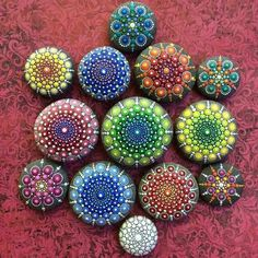 Australian artist paints ocean rocks with colourful dots to turn them into mandalas