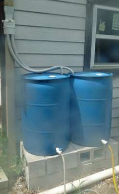 Example of a diverter design to harvest rainwater in two barrels at the same time.