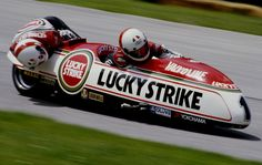 Egbert Streuer of the Netherlands with his sidecar passenger Bernard Schnieders rides the #1 Lucky Strike LCR-Yamaha combination during the Austrian motorcycle sidecar Grand Prix on 7 June 1987 at the Salzburgring Circuit in Salzburg, Austria.