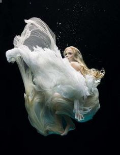 Raphael Dallaporta's amazing underwater shots of dresses designed by top fashion designers