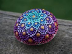 Beautiful and whimsical mermaid-inspired hand-painted Dot Mandala Ocean Stone! I place these beautiful rocks in all of my indoor and outdoor potted plants, in the garden and on my windowsills and alters. They can be used to raise the vibrational frequency of any environment. Some also use painted stones as paperweights :) All of my stones are painted with acrylic paint and sealed for indoor/outdoor use. Rock Size: ~2.5 x ~2 × 1.5 Initialed on bottom. Your stone will be boxed and ship...
