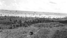 Guam in the Mariana Islands is pictured on Jul. 27, 1944, during U.S./Japanese warfare. (AP photo/Joe Rosenthal)