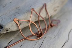 It can double as a larger shawl pin as well. Tulip part measures about 6 by 4.5 cm. Slider part is 10 cm long.