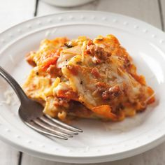 Vegetable-and-Ravioli Lasagna | Fresh spinach ravioli are a clever shortcut for making lasagna: Each ravioli is already a mini layer of pasta, cheese and vegetable. This recipe is especially fast to make using pre-roasted or grilled vegetables from the deli counter.