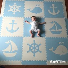 A fun light blue and white Nautical Themed foam play mat is perfect for a baby's nursery or playroom. These are cushioned mats that can be used directly on hard wood or tile floors.