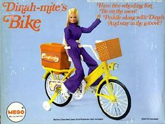 DINAH-MITE'S BIKE is motorized, and the pedals actually turn. The batteries are carried in the basket on the back.