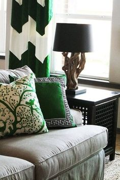 Kelly green is showcased in a variety of patterns in this living room corner, from chevron to greek key to whimsical naturescape.