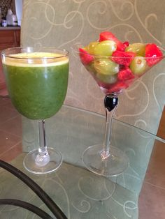 Freshly juiced spinach and pineapple and strawberry and grape fruit salad