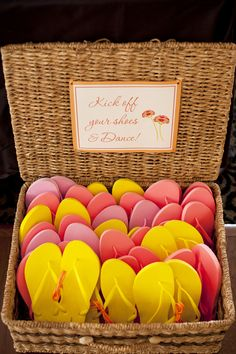 Basket of pink & yellow flip flops for guests| Photo by: segallphotography.com