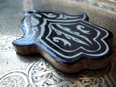 Ceramic Moroccan Berber hand of Fatima tile.