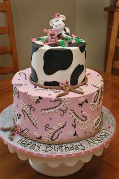 Cow Birthday Cake - IMBC icing and piping; fondant rope border, cow patches and topper.  Request was for 2 tier cow cake- top being cow print, bottom pink bandana!  Thanks cc-ers for help with inspiration on cow!