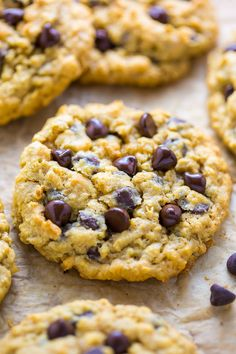 Holy YUM! Thick and Chewy Oatmeal Chocolate Chip Cookies. Perfect for holiday baking.