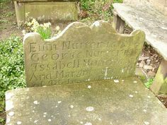 The gravestone of 'Nutter' in the Newchurch church graveyard.  It is believed to be the burial place of Alice Nutter who was a Pendle Witch in the 1500. She was put on trial and hung for being a witch. There are two main reasons why Alice Nutter can not be buried here. 1. witches were often buried at cross roads 2. the first date on the grave starts '16' which means that headstone was placed there many years after Alice had died.  but its still a nice idea. (2008)