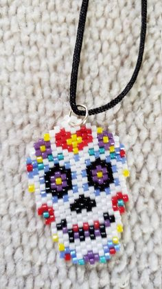 Items similar to Day of the dead - Beaded sugar skull necklace on Etsy Beaded Bracelet Patterns, Bead Loom Patterns, Beaded Bracelets, Skull Necklace, Beaded Skull, Loom Beading, Sugar Skull, Skulls, Jewelry Crafts