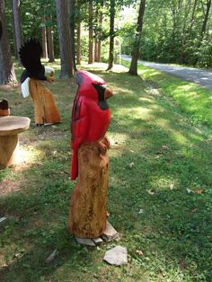 Cardinal chainsaw carving by Carvnstitch