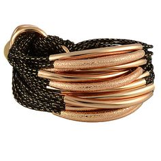 Gillian Julius Multi Tube Bracelet, Light Rose Gold & Sandblast | Black Cord. Multi strand bracelet consisting of 20 rose gold threaded waxed cotton cords. Each cord of bracelet features either a rose gold or rose gold sandblasted tube. $319