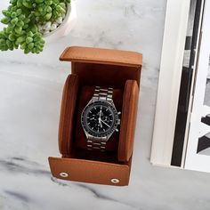 Our Oval Leather Travel Case is designed to hold one timepiece. It's…