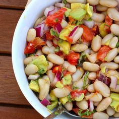 White Bean Salad with Lemon Vinaigrette Recipe Salads with lemon juice, olive oil, fresh basil, garlic, lemon, mustard, pepper, salt, cannellini beans, tomatoes, avocado, sweet onion