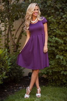 The Ivy is our best ever selling dress and now it comes in this STUNNING Plum! Classic a-line fit with larges pleats in the skirt. Also features a simple round neckline, cap sleeves and princess seams. This dress has been a favorite among brides!