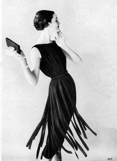 Enka Rayon ad, 1957.  Blending 1920's 'flapper girl' with chic of 1950's ultra tayloring