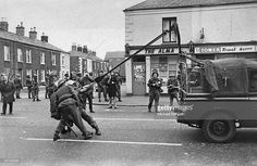793bbfe2f2 Soldiers of the British Army try out an experimental catapult teargas  launcher on the Falls Road Belfast 1970 x