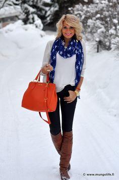 white top, black pants, orange purse and bracelet, gold jewelry, blue scarf