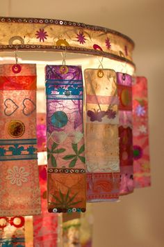 Three Tier Paper Chandelier (detail) by all things paper, via Flickr