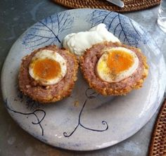 Scotch Egg Recipe:  Coat an egg with sausage, bread it and deep-fry it. Bake instead of deep-fry