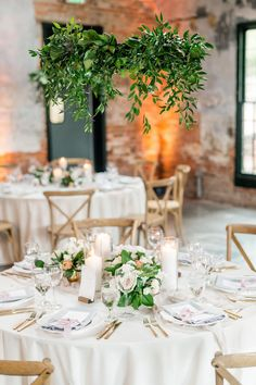 This elegant wedding in an industrial rice mill employs romance galore! Catch those greenery hoop chandeliers at the reception? #weddingflowers #floralchandeliers #weddinggreenery #elegantweddings