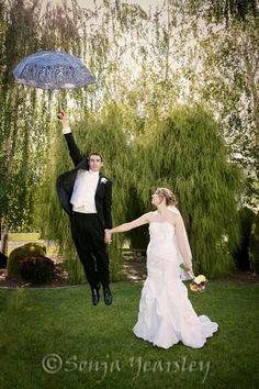 Groom going up holding an umbrella wedding photos