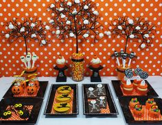 Orange and Black Halloween Inspired Dessert Table -> Look at the Ghosts in the trees!