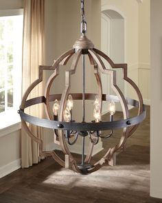 The transitional Socorro lighting collection by Sea Gull Lighting features a classic, barbed Quatrefoil profile which is wholly updated by combining a distressed Cerused Oak finish on the decorative silhouette with the rich Stardust finish on the metal bobeches and decorative strapping to create undeniable rustic charm. The collection includes four- and six-light hall/foyer pendants which also are perfect for dining room lights.