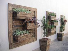 Love to do this on my backyard fence. Vertical Garden Planter