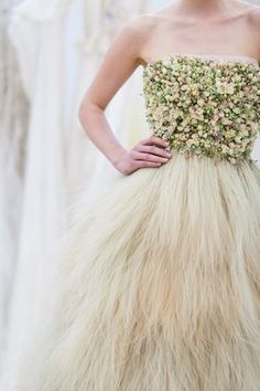 Wedding dress made of flowers. The skirt and trains of the dress were made of little bunches of stipa - this is a grass that is very soft and feels like fur.