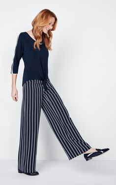 Our trendy wide leg pant flows elegantly with every step you take while the striped pattern elongates your look to keep you looking sleek and chic. Every Step You Take, Striped Pants, Wide Leg Pants, Chic, Pattern, Tops, Fashion, Wide Leg Trousers, Stripped Pants