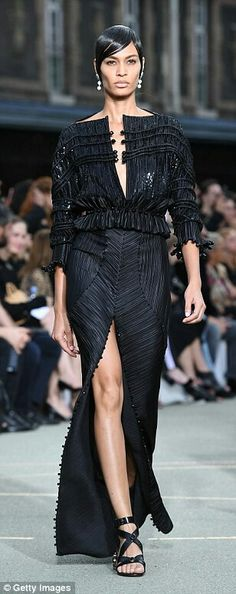 Supermodel Joan Smalls sleek hairstyle wearing Givenchy