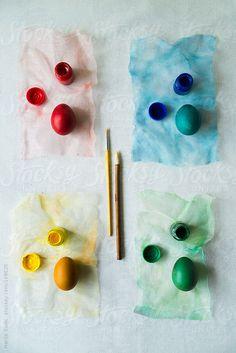 Red, yellow, blue, green easter eggs by Marija Savic #stocksy #realstock