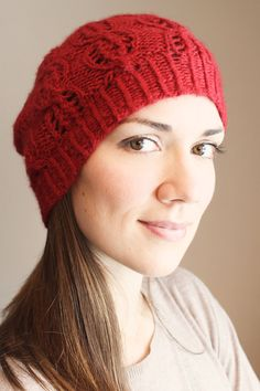This beautiful knitted red beanie is made of 100% baby alpaca wool, decorated with an individual cable pattern.
