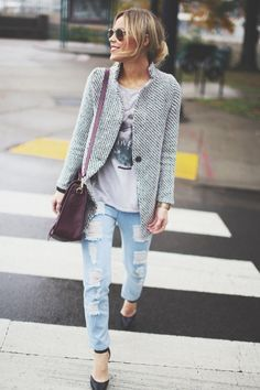 Fancy coat dressed down with ripped denim.