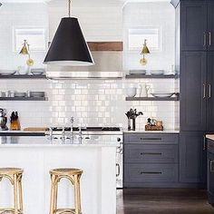 Black and white and chic all over!  We can't get enough of these gorgeous black-and white kitchens you guys are sharing! ✨Tap the link in our profile to see more 'tuxedo kitchens' shared from our #MyOKLStyle feed.✨ [design: @jasonarnoldinteriors, : @alyssarosenhack] #regram