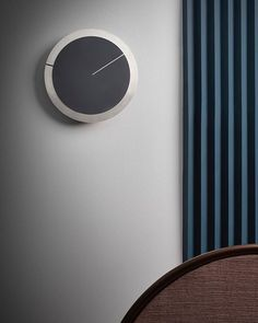 BLOOM is a minimalist wall clock that creates a visual game bya superposition of three circular pieces emulating a traditional clock. This clock conveys our philosophy of balance betweenplayfulness and elegance.