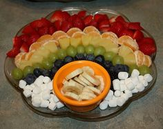 A rainbow fruit platter with marshmallow clouds?  LOVE it!