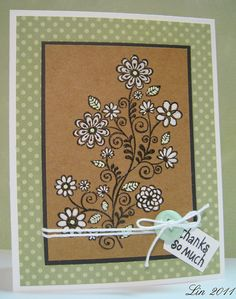really pretty folkoric flower image embossed in black & colored with white on kraft...beautiful!!