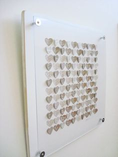 Adore! Guests write on little hearts wishing the couple work - then mount with a frame. Think it has staying power?