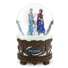 Frozen Snowglobe Disney Store Released - 2013-11-04  Snowball of fun  Snow swirls on the inside of the globe and covers the base of this Frozen Snowglobe that plays Let It Go. Anna and Elsa are joined by Olaf the snowman to provide warm memories of Disney's wintry new adventure.