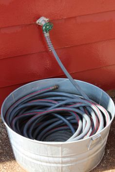Aluminum wash tub hose holder--great idea!