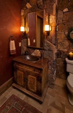 Large stone tiles makes for a rustic, romantic bathroom.