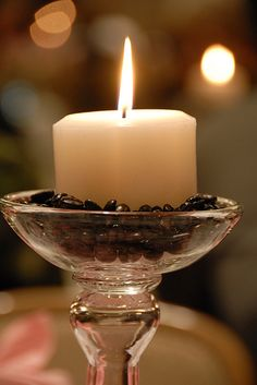 Use coffee beans or lentils/dried beans in candle holders.  Would the coffee beans give a nice aroma?