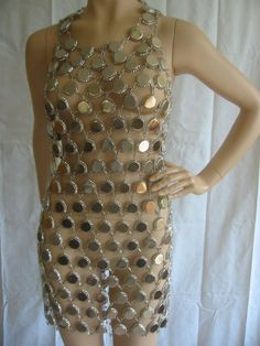 Fabulous Paco Rabanne Style Metal Link Dress This fabulous dress is made of silver metal bottle caps that are linked together to create this wonderful dress. The caps at the very top of the neckline are filled with wax to eliminate Weird Fashion, Look Fashion, Diy Fashion, Fashion Design, Couture Fashion, Concert Dresses, Recycled Dress, Rave Costumes, Paco Rabanne