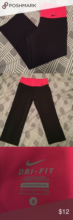 Black Nike dri-fit workout crops with pink band Black Nike dri-fit workout crops with pink band. Size Small. Nike Pants Capris
